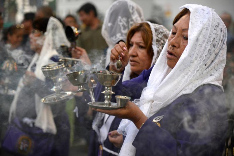 Women hold incense and chant prayers in Los Angeles in this Oct. 25, 2015, file photo. The Vatican newspaper, L'Osservatore Romano, published several commentaries reflecting on the possibility of allowing laypeople, including women, to preach at Mass. (CNS photo/Mike Nelson, EPA)