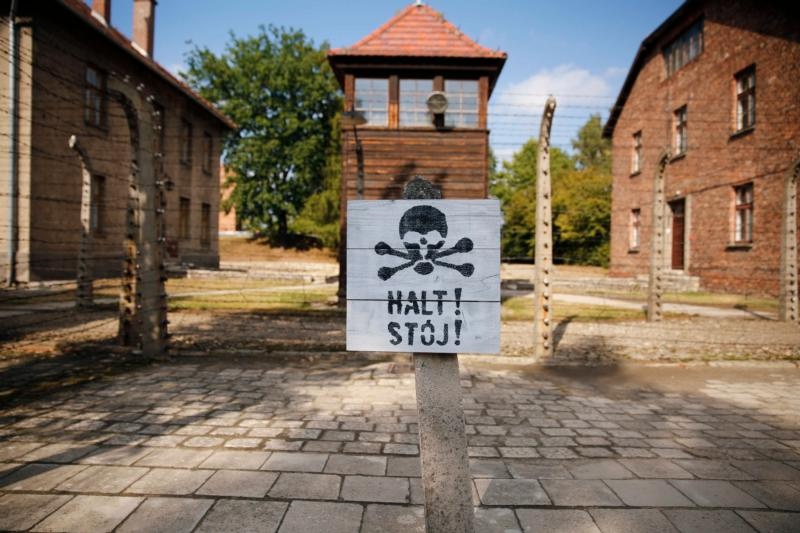 A guard tower is seen beyond on area enclosed with barbed wire at the Auschwitz-Birkenau Memorial and State Museum in Oswiecim, Poland. The Auschwitz memorial and museum is setting aside days exclusively for World Youth Day pilgrims who want to tour the former Nazi death camp. (CNS photo/Nancy Wiechec)