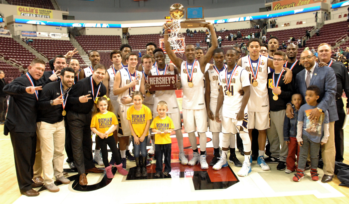 The Roman Catholic basketball team and faithful celebrate their class AAAA state championship win March 19 in Hershey, Pa. (Photo by D'Mont Reese)