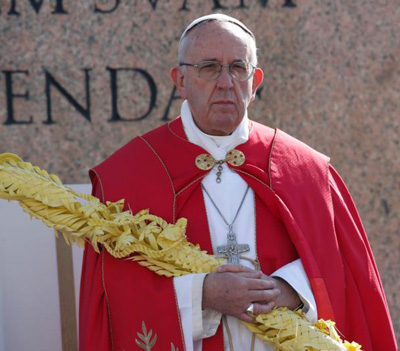Pope Francis holds palm fronds as he leads a ceremony at the obelisk during Palm Sunday Mass in St. Peter's Square at the Vatican March 20. (CNS photo/Paul Haring)