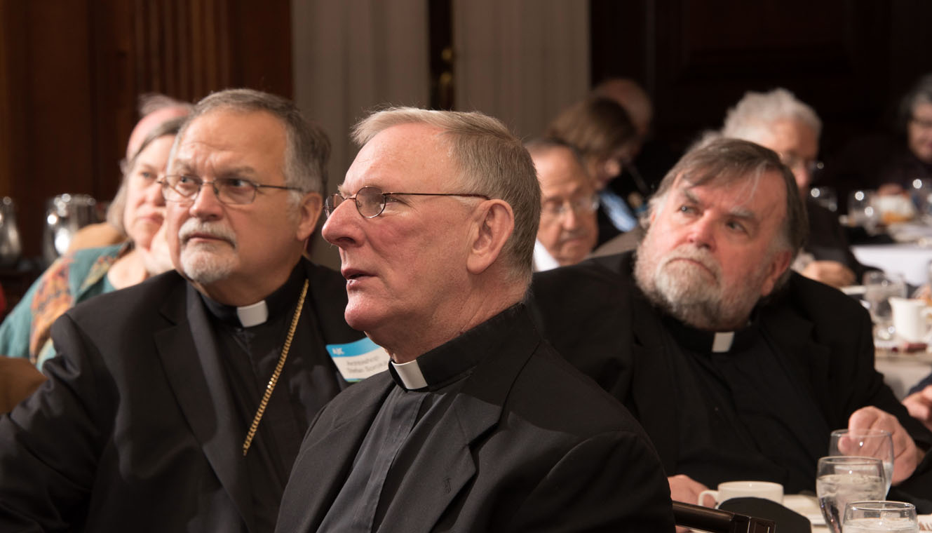 Local clergymen including Ukrainian Catholic Archbishop Stefan Soroka (left) and Ukrainian priest Father John Fields (right), listen to lecturer Felice Gaer speak April 11 in Philadelphia about violations of religious freedom around the world, and what might be done to address them.