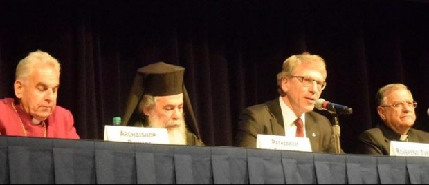 "Speakers are seen on a panel April 19 during the ""Pursuing Peace and Strengthening Presence: The Atlanta Summit of Churches in the USA and the Holy Land"" in Atlanta. Pictured are Archbishop Suheil Dawani of the Episcopal Diocese of Jerusalem; Greek Orthodox Patriarch Theophilos III of Jerusalem; the Rev. Olav Fykse Tveit, general secretary of the World Council of Churches; and Latin Patriarch Fouad Twal of Jerusalem. (CNS photo/courtesy  Rev. Mitri Raheb)"