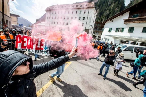 People demonstrate against the Austrian government's planned re-introduction of border controls at the Brenner Pass April 24. Bishop Agidius Zsfikovics of Eisenstadt has refused to allow an anti-refugee border fence across land belonging to his diocese, saying the government-backed move violates Christian values. (CNS photo/Jan Hetfleisch, EPA)