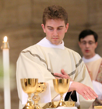 As a transitional deacon, Rev. Mr. Matt Biedrzycki assists at the altar during Mass at St. Charles Seminary. (Sarah Webb)