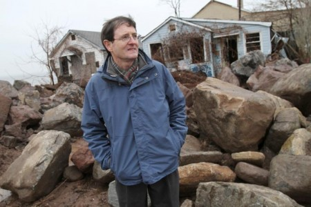 Patrick Jordan, former managing editor of the Catholic Worker newspaper, stands near abandoned cottages that were once part of the Spanish Camp enclave in the Staten Island borough of New York Dec. 9, 2012. Jordan and his wife Kathleen, who were close associates of Catholic social activist Dorothy Day, had lived in one of the cottages. Day was a part-time resident of the community and later in her life spent much of her time there. (CNS photo/Gregory A. Shemitz)