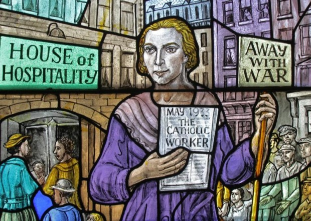 Dorothy Day, co-founder of the Catholic Worker Movement and its newspaper, The Catholic Worker, is depicted in a stained-glass window at Our Lady of Lourdes Church in the Staten Island borough of New York. (CNS photo/Gregory A. Shemitz)