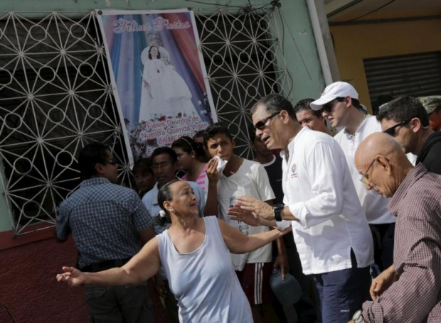 Ecuador's President Rafael Correa speaks with residents April 18 in Portoviejo after an earthquake off the country's Pacific coast. At least 272 people died, nearly 3,000 were injured and thousands were left homeless in the April 16 magnitude-7.8 earthquake. (CNS photo/Henry Romero, Reuters)