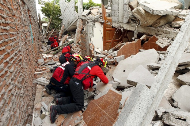 Firefighters search for survivors in Manta, Ecuador, April 17 after an earthquake struck the previous day off the country's Pacific coast. At least 272 people died, nearly 3,000 were injured and thousands were left homeless in the  magnitude-7.8 earthquake. (CNS photo/Guillermo Granja, Reuters)