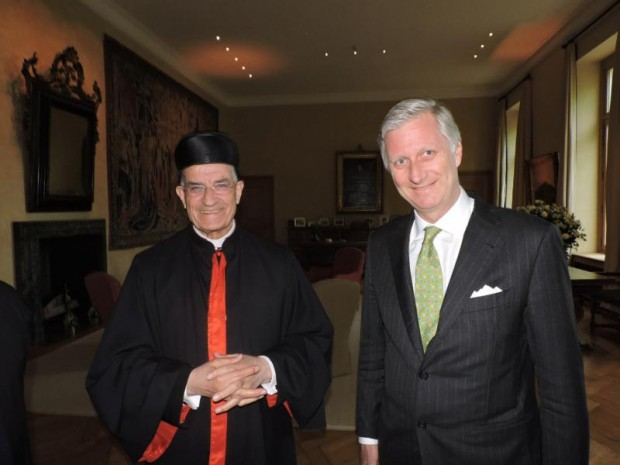 Lebanese Cardinal Bechara Rai, patriarch of Maronite Catholics, poses with King Philippe of Belgium at the king's residence April 27 in Brussels. In a speech to the European Parliament in Brussels, Cardinal Rai called for an end to wars and conflicts in the Middle East and for a return of the displaced to their countries of origin. (CNS photo/Bkerke, Maronite Catholic patriarchate)