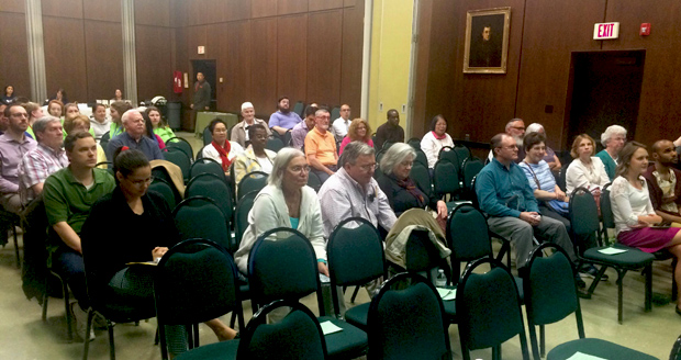 "Guests listen to Ricardo Simmonds' presentation on ""Laudato Si."""