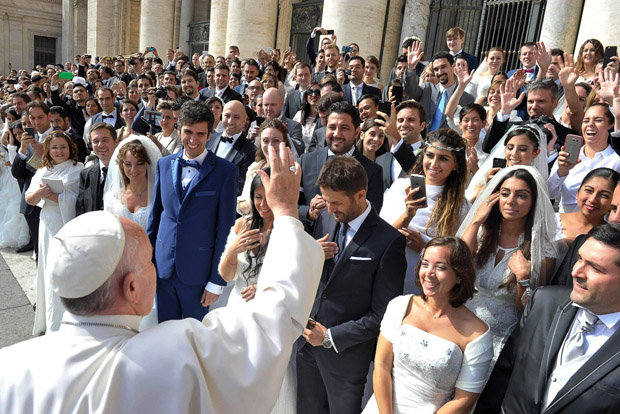 "Pope Francis greets newly married couples during his general audience in St. Peter's Square at the Vatican in this Sept. 30, 2015, file photo. Pope Francis' postsynodal apostolic exhortation on the family, ""Amoris Laetitia"" (""The Joy of Love""), was released April 8. The exhortation is the concluding document of the 2014 and 2015 synods of bishops on the family. (CNS photo/L'Osservatore Romano)"