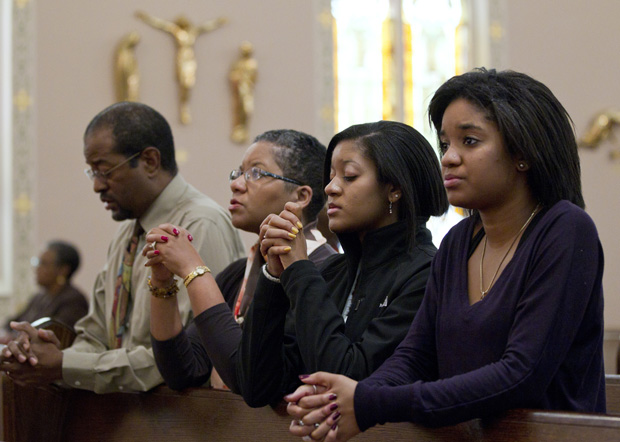 "A family prays after arriving for Sunday Mass in 2011 at St. Joseph's Catholic Church in Alexandria, Va. Pope Francis' postsynodal apostolic exhortation on the family, ""Amoris Laetitia"" (""The Joy of Love""), was released April 8. (CNS photo/Nancy Phelan Wiechec)"