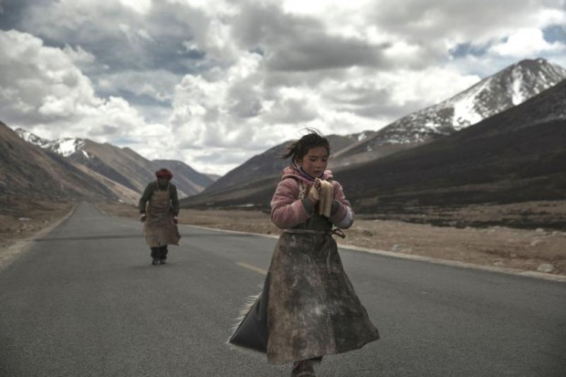 "This is a scene from ""Paths of the Soul,"" a Chinese film production about Tibetan Buddhists on pilgrimage, that won the Signis Jury Award at the 30th annual Filmfest DC in Washington, which concluded April 24.  Signis is the official world Catholic association for communication. (CNS photo/courtesy of Icarus Films)"