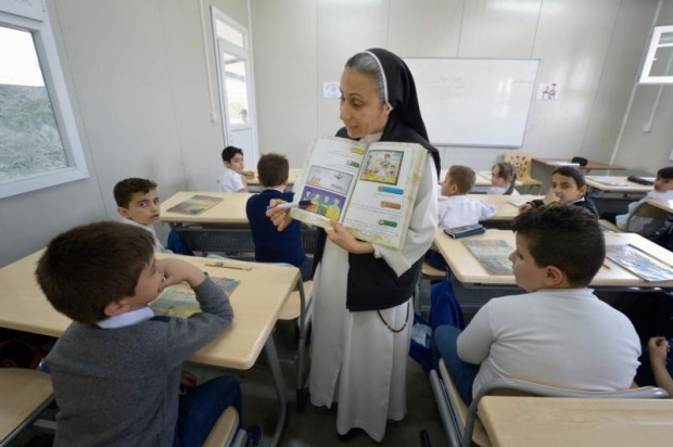 Dominican Sister Lemia Atala instructs students at the Al Bishara School in Ankawa, Iraq, April 7. The Islamic State group displaced the students and the Dominican Sisters in 2014. (CNS photo/Paul Jeffrey)
