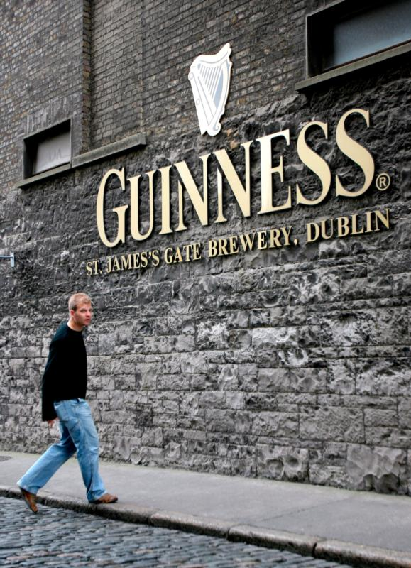 A young man walks outside the St. James's Gate Guinness Storehouse in 2007 in Dublin. Young people in Ireland are increasingly looking for an alternative to the drinking scene, with up to 8,000 teenagers signing up to the Pioneer Association last year. (CNS photo/Andy Rain, EPA)