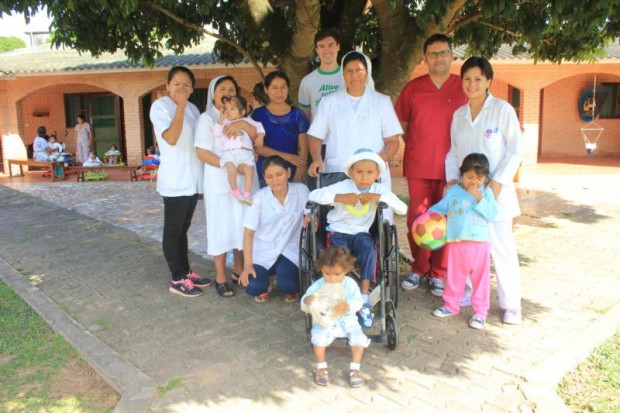 Lay Catholic missionary Connor Bergeron of Reston, Va., center back row, poses in this 2015 photo with people he served during his 16 months of working with the Salesian Lay Missioners in Yapacani, Bolivia. (CNS photo/courtesy of Connor Bergeron)
