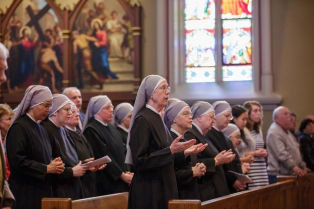 Members of the Little Sisters of the Poor pray during Mass at the Basilica of the Sacred Heart at the University of Notre Dame in Indiana April 9. Later the congregation was awarded the Evangelium Vitae Award for outstanding service to human life, presented annually since 2011 by the university's Center for Ethics and Culture. (CNS photo/Peter Ringenberg, Notre Dame Center for Ethics and Culture)