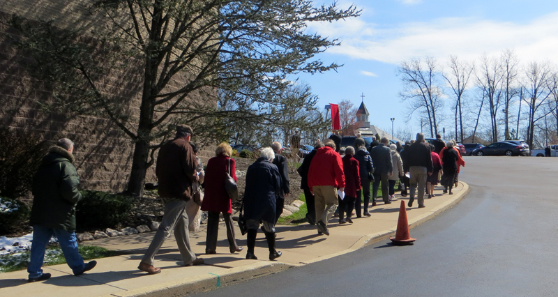 Legion of Mary members walk in procession on the St. Eleanor Church campus Sunday, April 10.