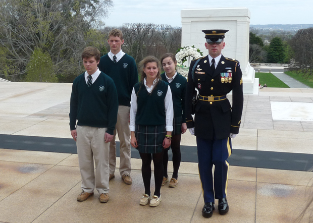 Four student representatives of 43 history students of Bishop Shanahan High School participate in a wreath laying ceremony March 31 at Arlington National Cemetery.