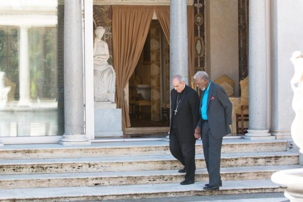 "Bishop Marcelo Sanchez Sorondo, chancellor of the Pontifical Academy of Sciences, is seen walking with Morgan Freeman, host of ""The Story of God,"" now showing on the National Geographic Channel on cable TV. (CNS photo/Matthew Paul, National Geographic Channels)"