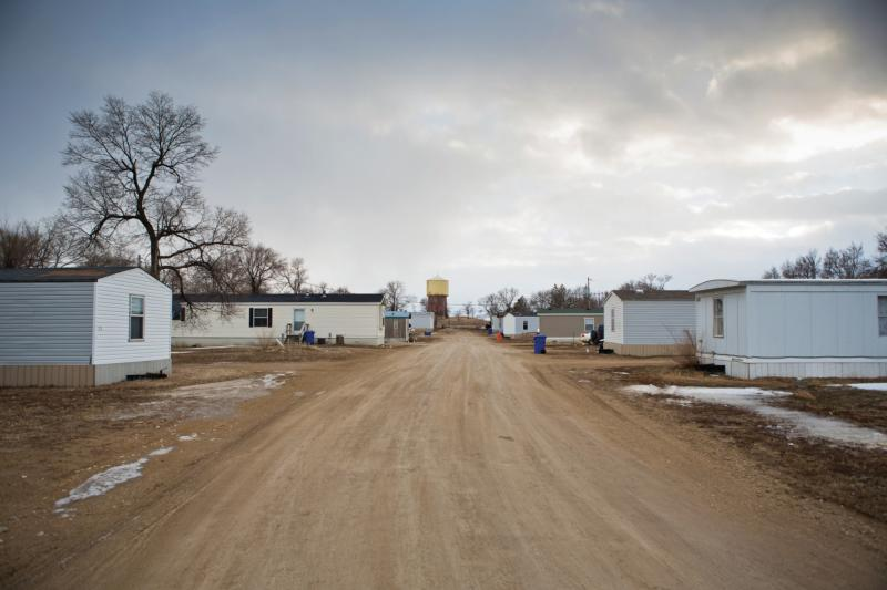 Homes line a dirt road in 2013 on the Rosebud Reservation in south central South Dakota. Poverty and addiction are major contributing factors to the high suicide rate on the Lakota reservation. (CNS photo/Rich Kalonick, Catholic Extension)