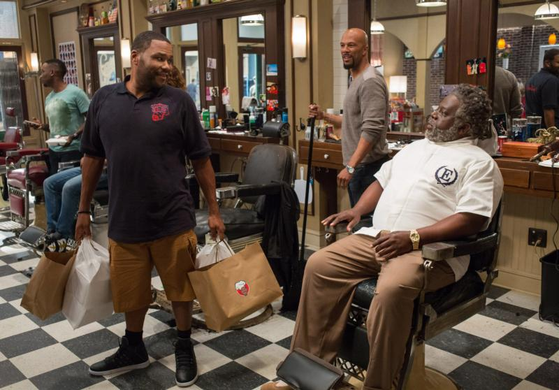 "Anthony Anderson, Common and Cedric the Entertainer star in a scene from the movie ""Barbershop: The Next Cut."" (CNS photo/Warner Bros.)"