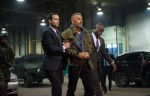 """Kevin Costner, center, stars in a scene from the movie """"Criminal."""" (CNS photo/Lionsgate)"""