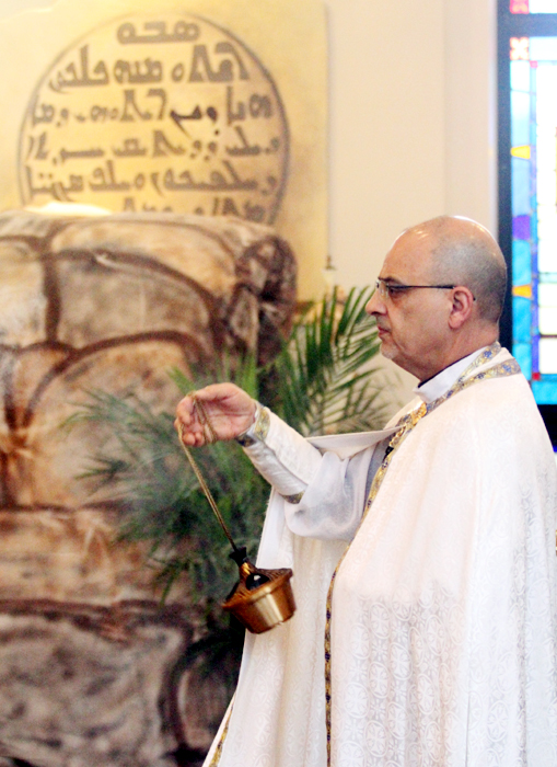Father Vincent Farhat, pastor of Saint Maron Maronite Catholic Church, incences the church.