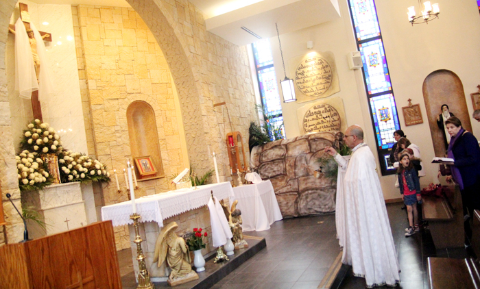 Father Vincent Farhat, pastor, incences the altar at Saint Maron Meronite Catholic Church in South Philadelphia.