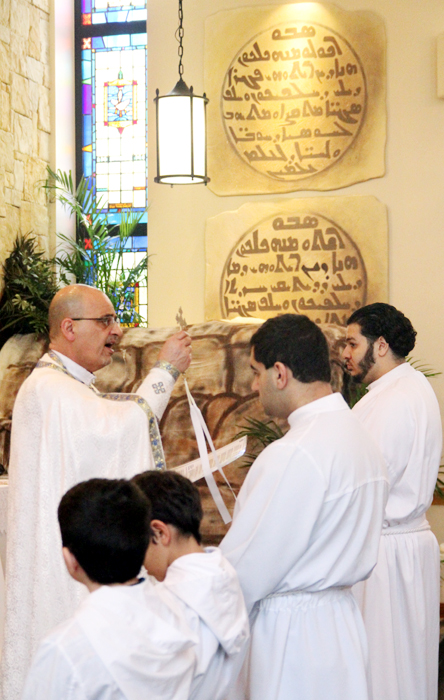 Father Vincent Farhat offers a final blessing.