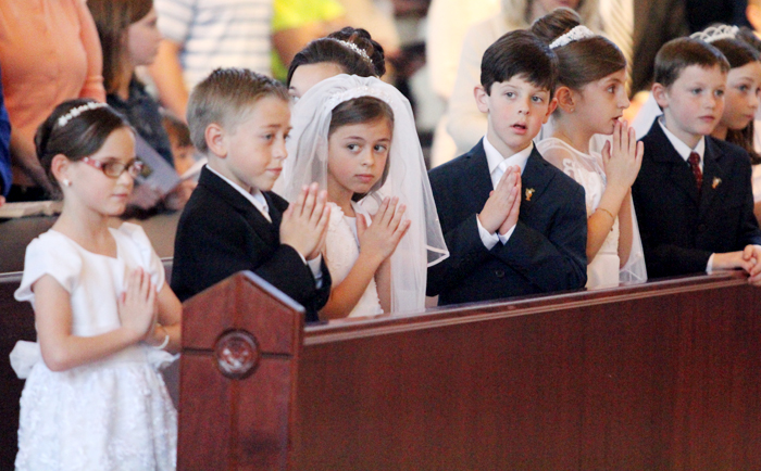 Second grade student were the first of three groups of students to receive first holy communion during mass over the next few weeks.