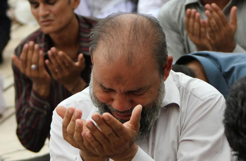 Pakistani Muslims pray during Ramadan in Karachi. Church officials in Pakistan have backed a government plea to the international community not to demonize all Muslims because of acts of terrorism committed by a few extremists, reported ucanews.com. (CNS photo/Rehan Khan, EPA).