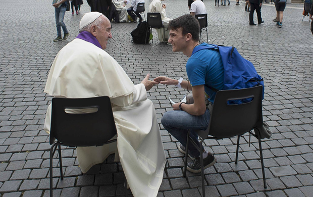 Pope Francis hears confession of a youth April 23 in St. Peter's Square at the Vatican. (CNS photo/L'Osservatore Romano via Reuters)