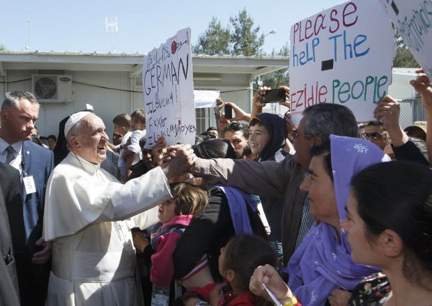 Pope Francis meets people at the Moria refugee camp on the island of Lesbos, Greece, April 16, 2016. (CNS photo/Paul Haring)