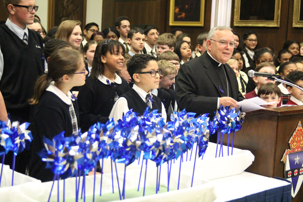 "Archbishop Charles Chaput leads about 150 students April 7 at the Archdiocesan Pastoral Center in the ""Pinwheels for Prevention"" event, part of the National Child Abuse and Prevention Month, in April. (Photos by Sarah Webb)"