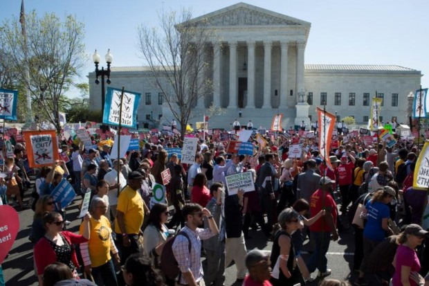 Demonstrators gather outside the U.S. Supreme Court in Washington April 18 as the justices hear oral arguments  in a challenge by several states to President Barack Obama's deferred deportation programs. (CNS photo/Tyler Orsburn)
