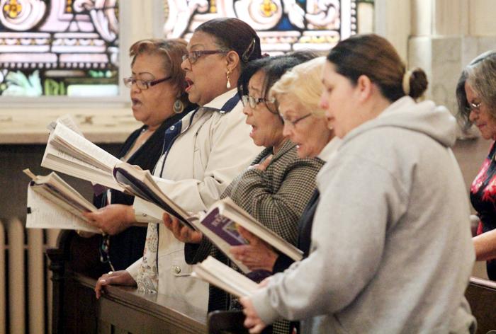 The Spanish Choir of St. Michael Church fill the church with their voices.
