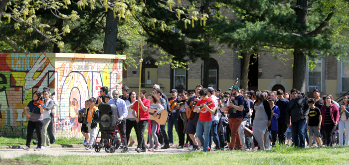 St. Michael Parish processes around Norris Square Park for it's second annual Great Mission outdoors that happens for five Sundays in the Easter season.