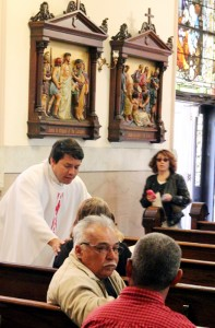 Father Arturo Chagala welcomes parishoners before mass.