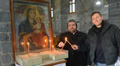 Syriac Orthodox Bishop Selwanos Alnemeh of Homs and John Pontifex of Aid to the Church in Need pose with candles in February at the Syriac Catholic Cathedral in Homs.  (CNS photo/Aid to the Church)