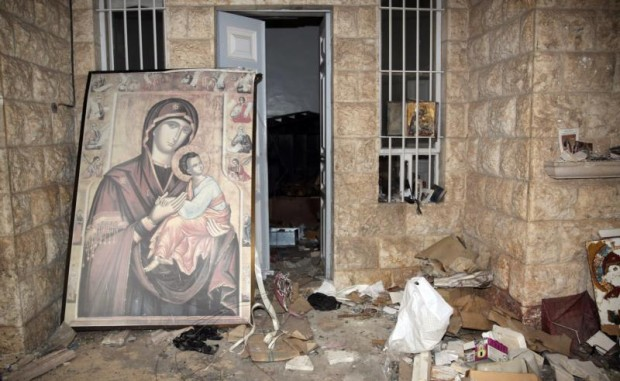 A painting of Mary and the Christ Child is is seen in 2014 at the damaged St. Thecla Orthodox monastery in the predominantly Christian town of Maaloula, Syria. Russia's Catholic Church has launched a joint project with Russian Orthodox leaders to rebuild churches and monasteries destroyed during the war in Syria. (CNS photo/Youssef Badawi, EPA)