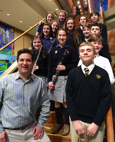 Alex Schmauk stands with his students from St. Joseph the Protector School, Glenside, before their performance with the Archdiocesan Honor Band at the March 22 Concert of Excellence at Philadelphia's Kimmel Center.