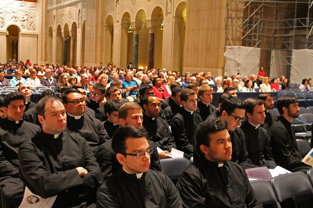 Seminarians from St. Charles Borromeo Seminary pray at the Basilica of the National Shrine of the Immaculate Conception during the archdiocesan pilgrimage. (Lou Baldwin)