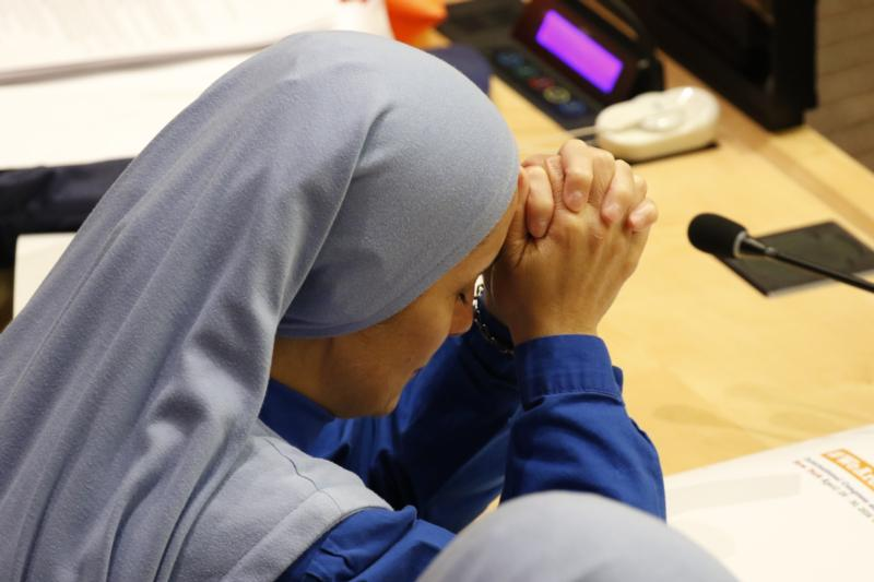 Iraqi-born Mother Olga of the Sacred Heart, founder of the Daughters of Mary of Nazareth, bows her head during a conference addressing the persecution of Christians and other minorities in the Middle East and Africa at the United Nations April 28. (CNS photo/Gregory A. Shemitz)