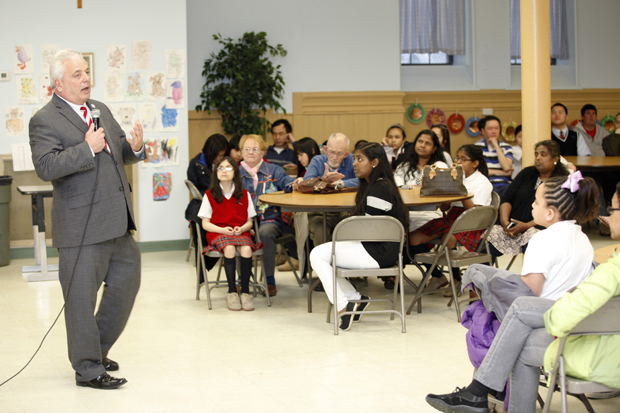 Upper Darby Township Mayor Tom Micozzie speaks with students of St. Laurence School, Upper Darby, March 31 at an assembly to recognize fourth through eighth grade students who achieved honors. Photo by Maria Tucker)