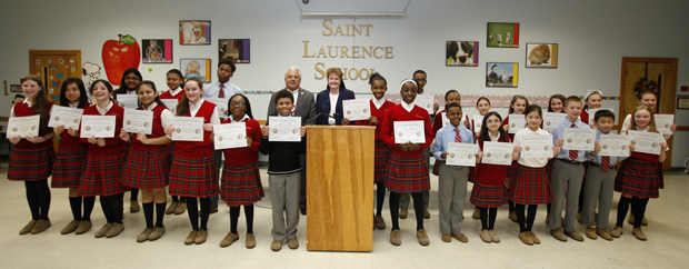 All the honorees display their certificates of achievement. (Maria Tucker)