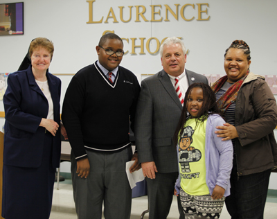 The Brissault family greets Mayor Tom Micozzie and St. Laurence School Principal Sister MaryAnne Bolger, I.H.M. (Maria Tucker)