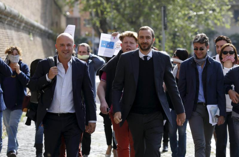 Journalists Gianluigi Nuzzi and Emiliano Fittipaldi, center, walk to their trial April 6 at the Vatican. Nuzzi and Fittipaldi are accused by the Vatican of soliciting the documents and exercising pressure on the defendants, especially Msgr. Vallejo Balda. (CNS photo/Remo Casilli, Reuters)
