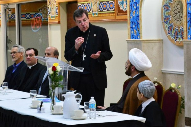 Detroit Archbishop Allen H. Vigneron  addresses Imam Mohammad Ali Elahi and those gathered at the Islamic House of Wisdom in Dearborn, Mich., April 5. (CNS photo/Mike Stechschulte, The Michigan Catholic)