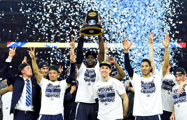 Villanova Wildcats forward Daniel Ochefu hoists the national championship trophy with teammates April 4 after defeating the North Carolina Tar Heels 77-74 in the 2016 NCAA Men's Final Four in Houston. Jenkins is a 2013 graduate of Gonzaga College High School in Washington. (CNS photo/Robert Deutsch-USA TODAY Sports via Reuters)